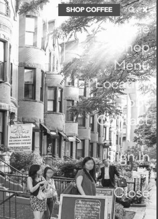 Cafe website with menu overlaid over a photo. The menu is in a transparent white and the photo background is of a sunny street in Boston. This photo is with the No coffee achromatopsia filter